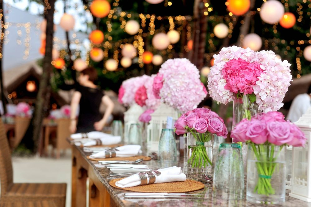 Pink peonies on a long wedding top table