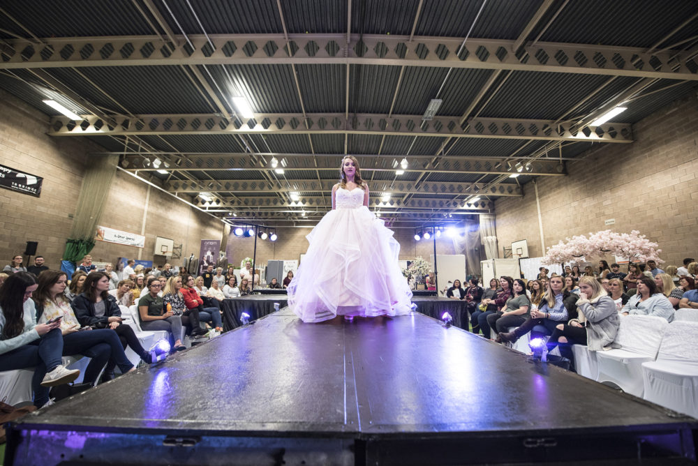 How wedding fairs can help you - woman on catwalk in wedding dress